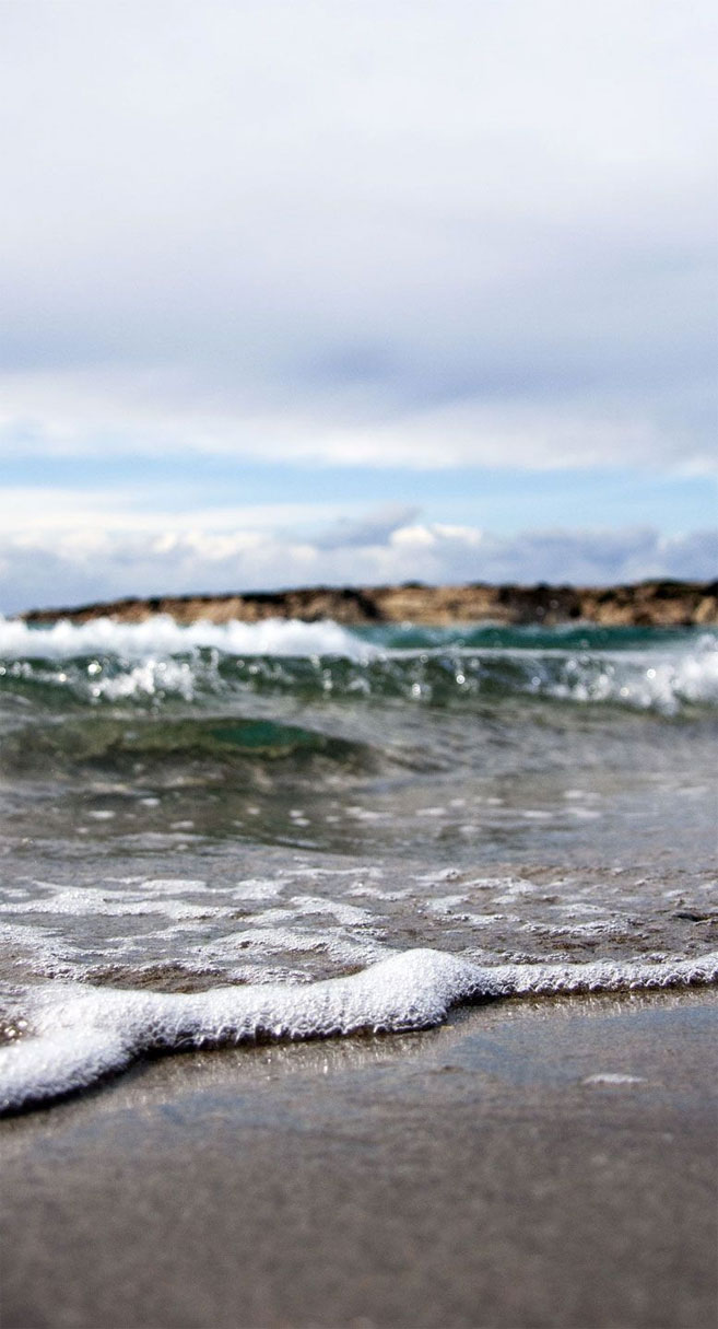 Ocean wave race to beach shore iphone wallpaper