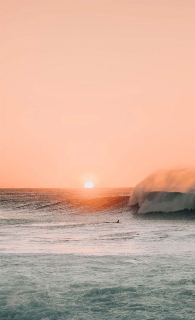 Peach sky beach iPhone wallpaper