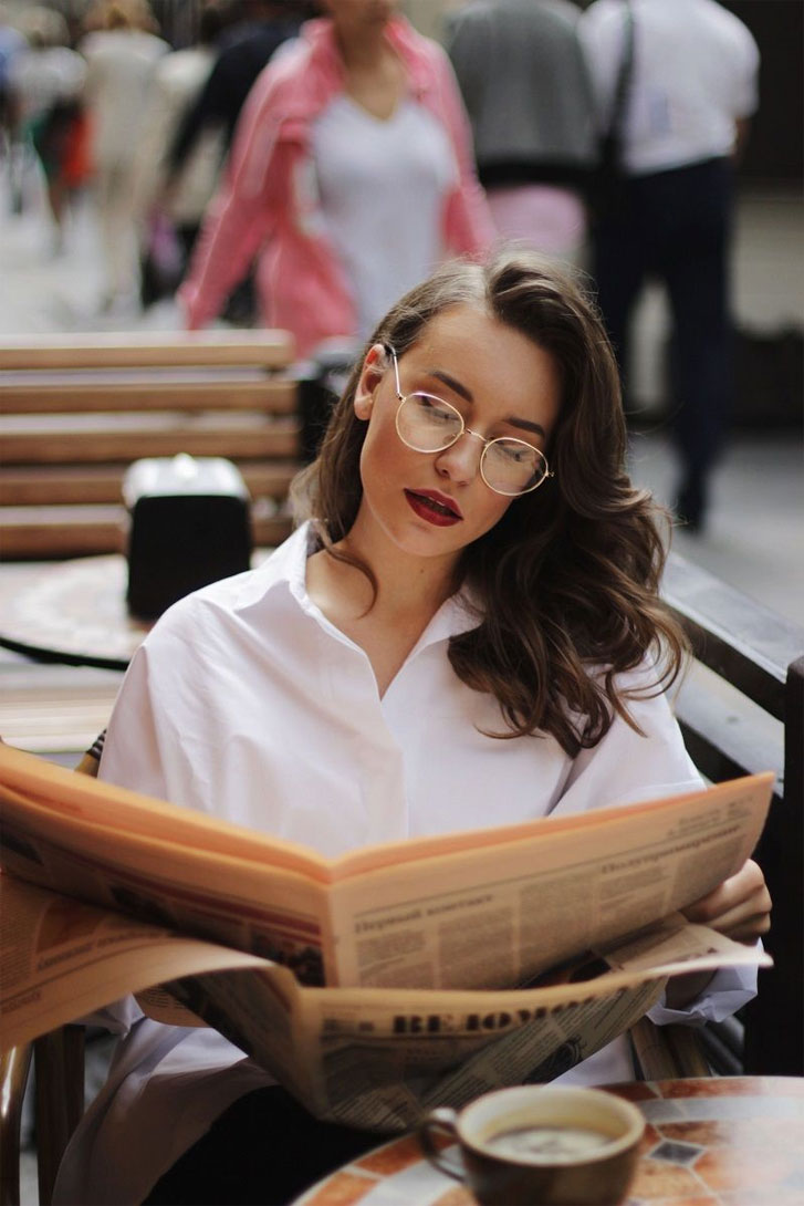 Coffee newspaper & pretty woman in the cafe