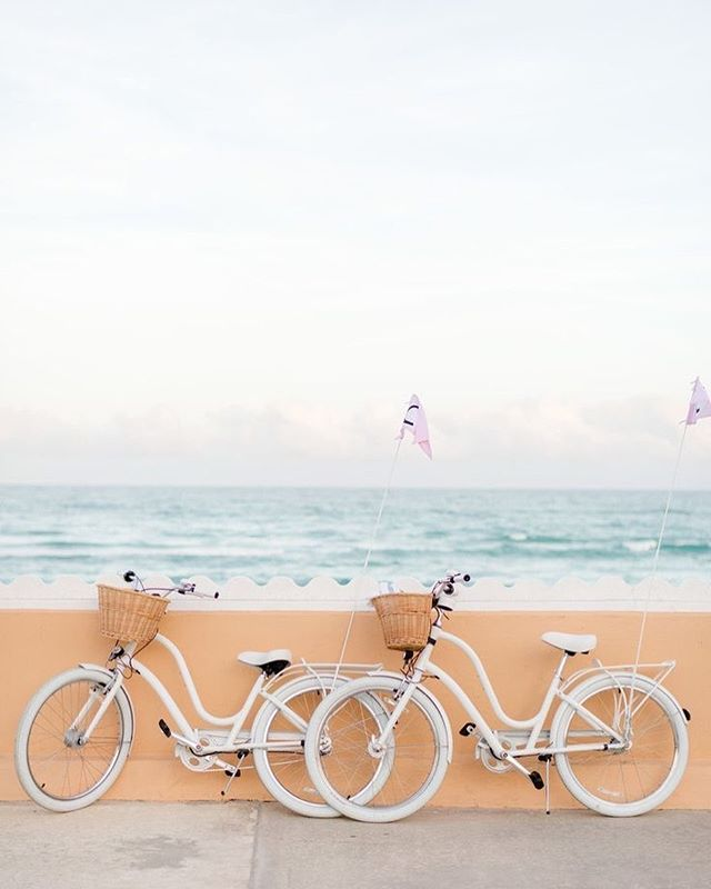 White bicycles on the beach