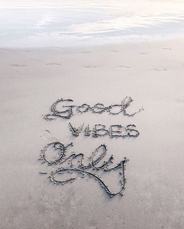 Good vibes only written on beach