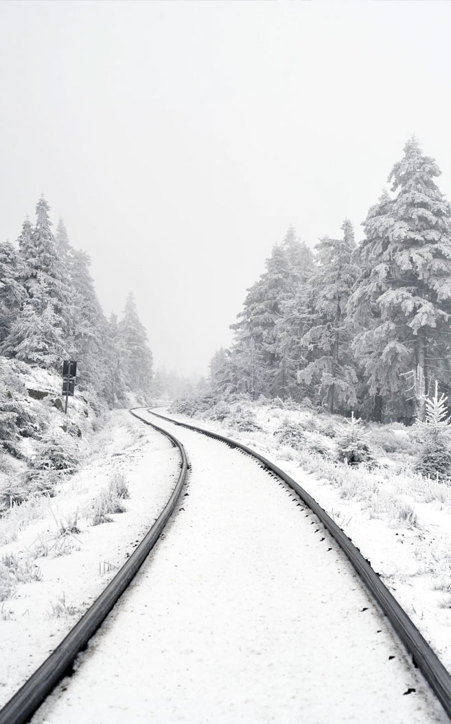 Beautiful snow covers railway