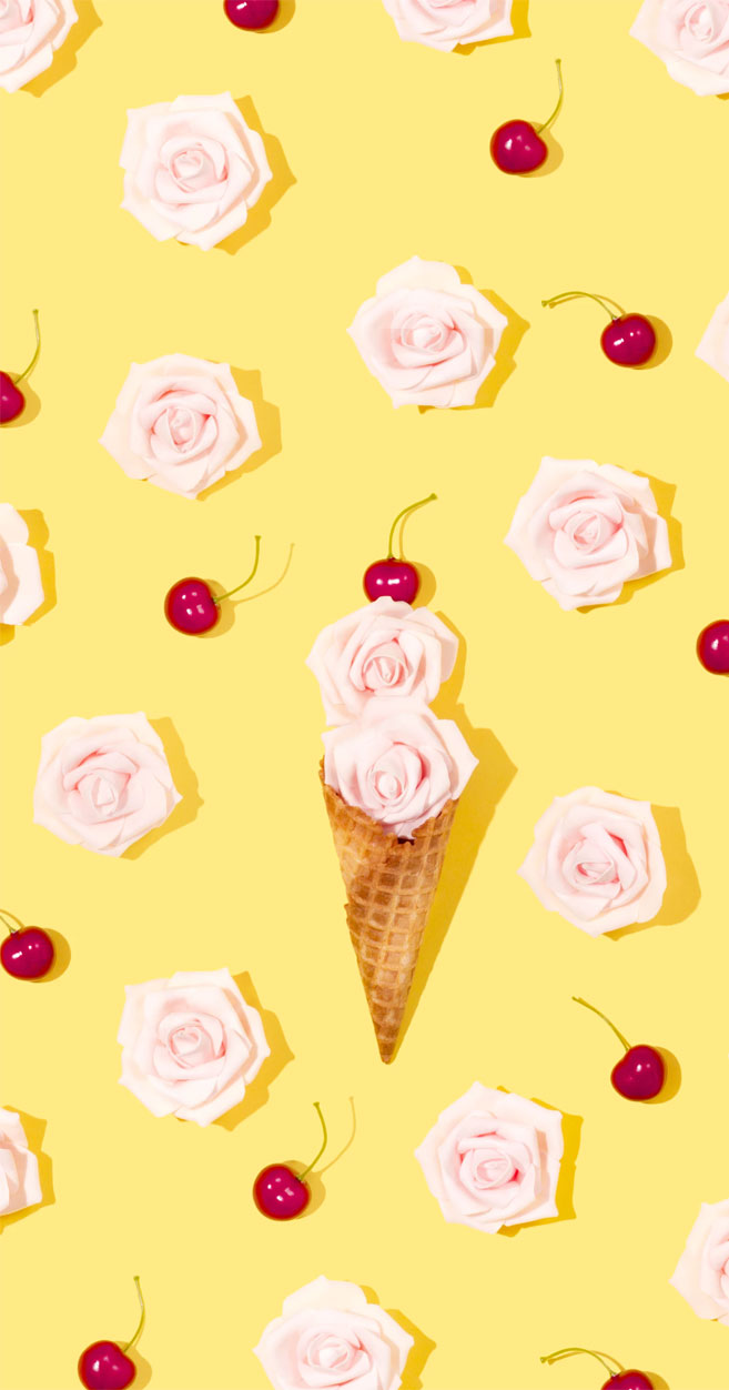 Ice cream cone and roses with cheerful yellow background